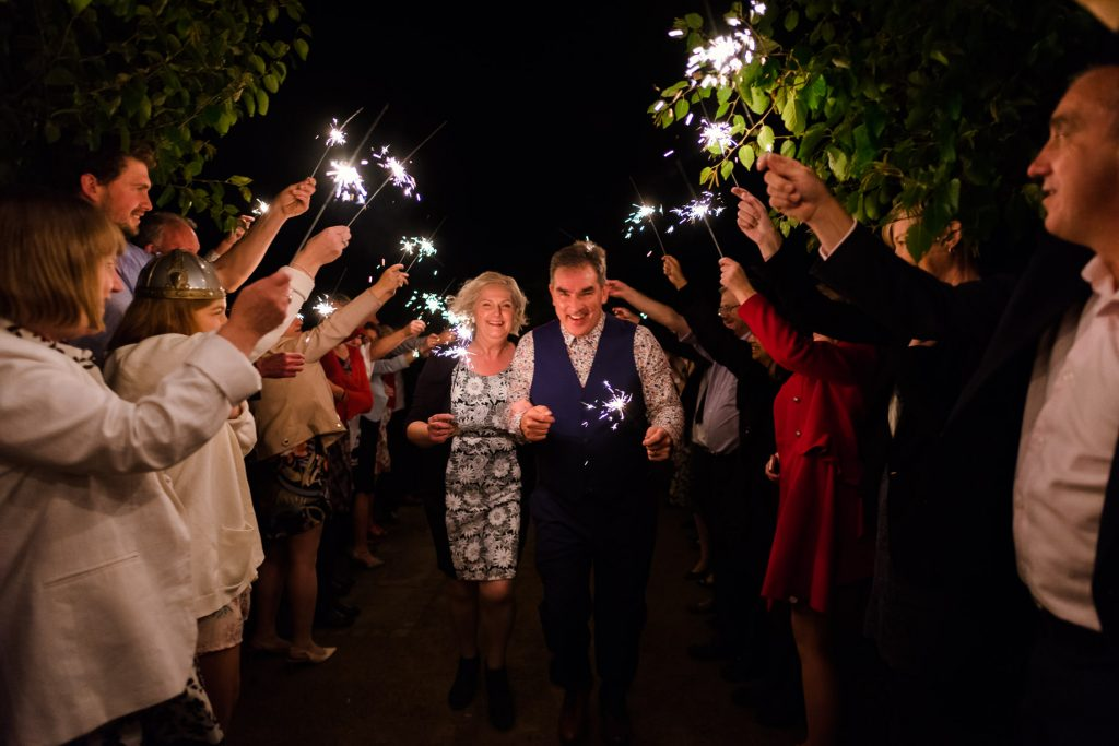 Sparkler exit at Back To The Garden Wedding captured by Norwich Wedding Photographer Andrew Kahumbu