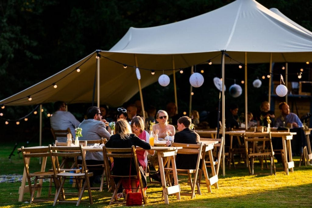 Outdoor reception under stretch tent at Ingoldisthorpe Hall boho wedding
