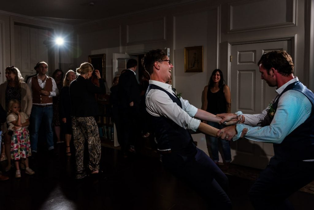 Groom and Best man dance during wedding reception