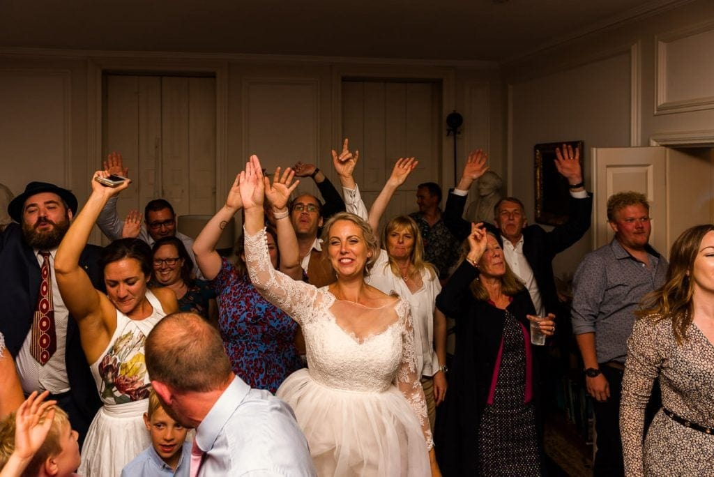 Bride dancing during wedding at Ingoldisthorpe Hall Wedding