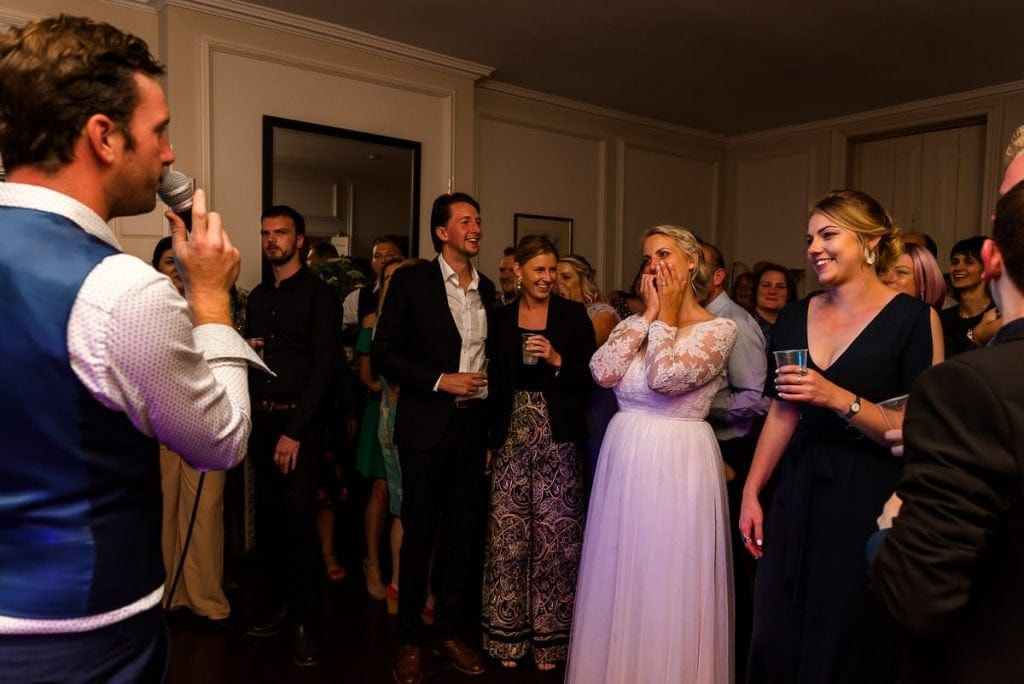 Groom sings to his wife during wedding reception