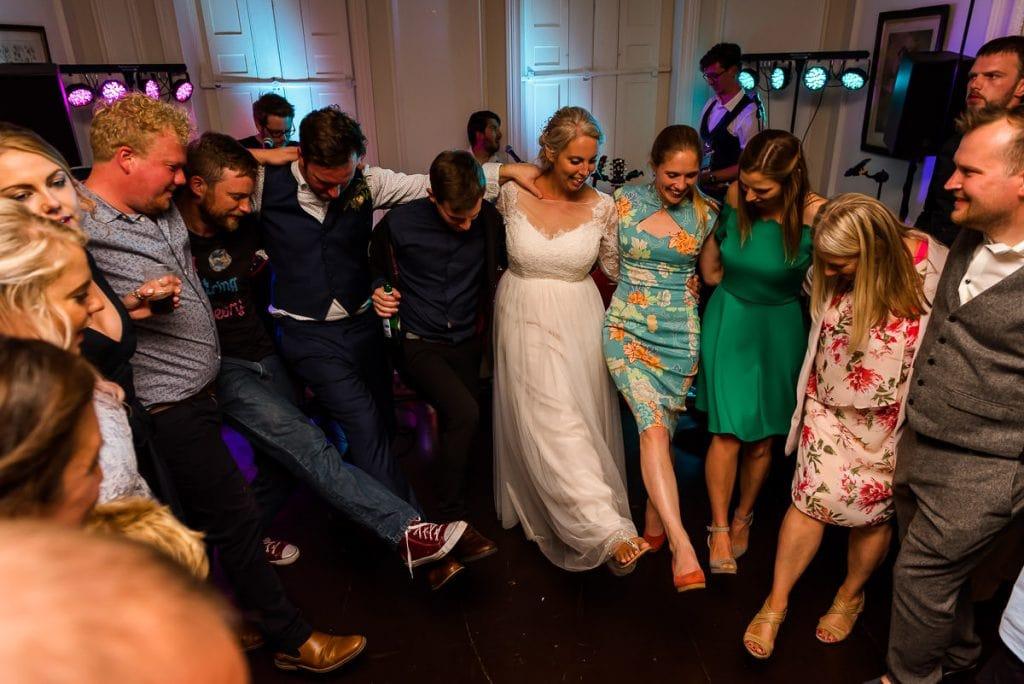 Group dance during boho wedding reception at Ingoldisthorpe Hall wedding