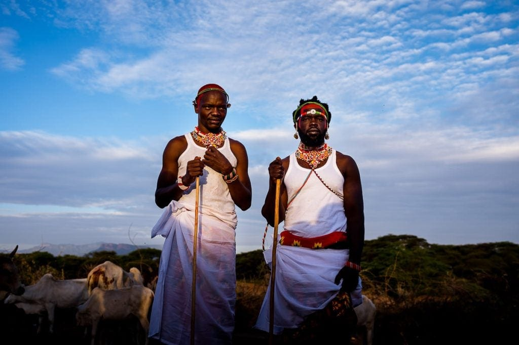 Samburu groom and best man at sunrise.