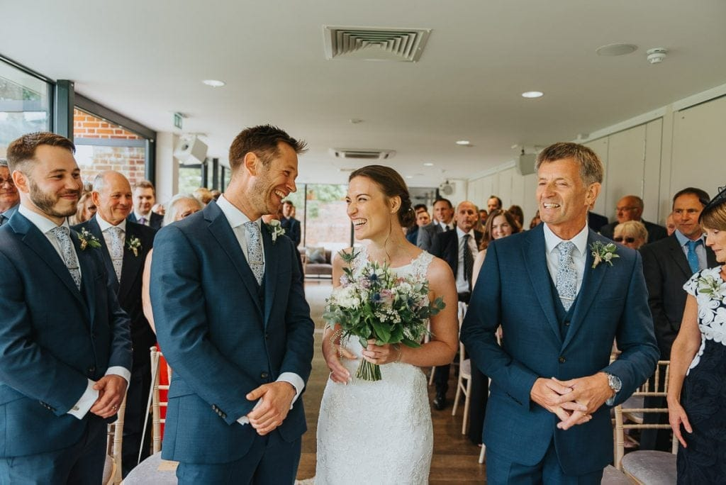 Bride and groom share a laugh during their wedding at Norfolk Mead Hotel