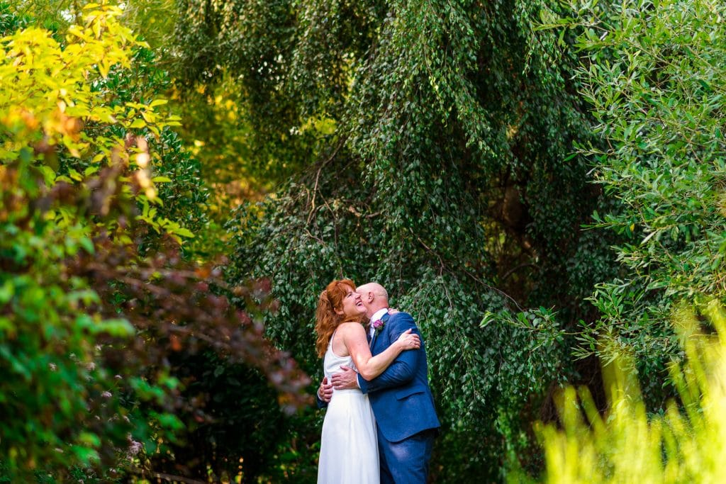 Newly wed couple portraits in luxurious garden