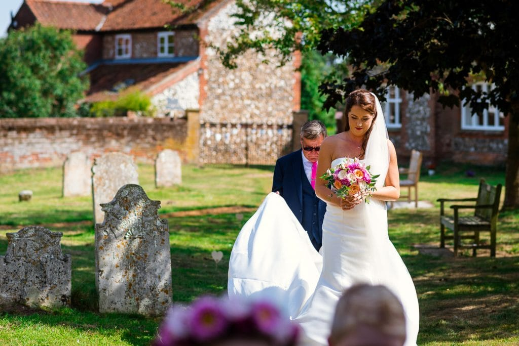 Bride and father arrive at All Saints Church in Horstead