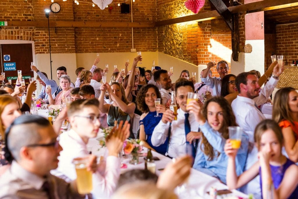 Wedding reception toasts at Horsted Tithe Barn