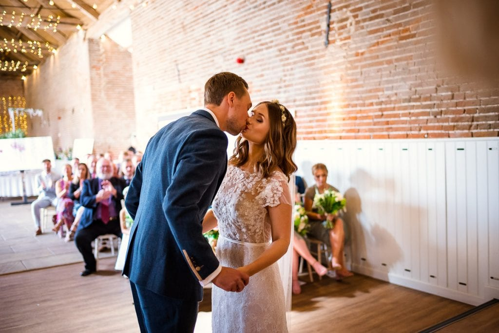 First kiss at during Manor Mews wedding ceremony
