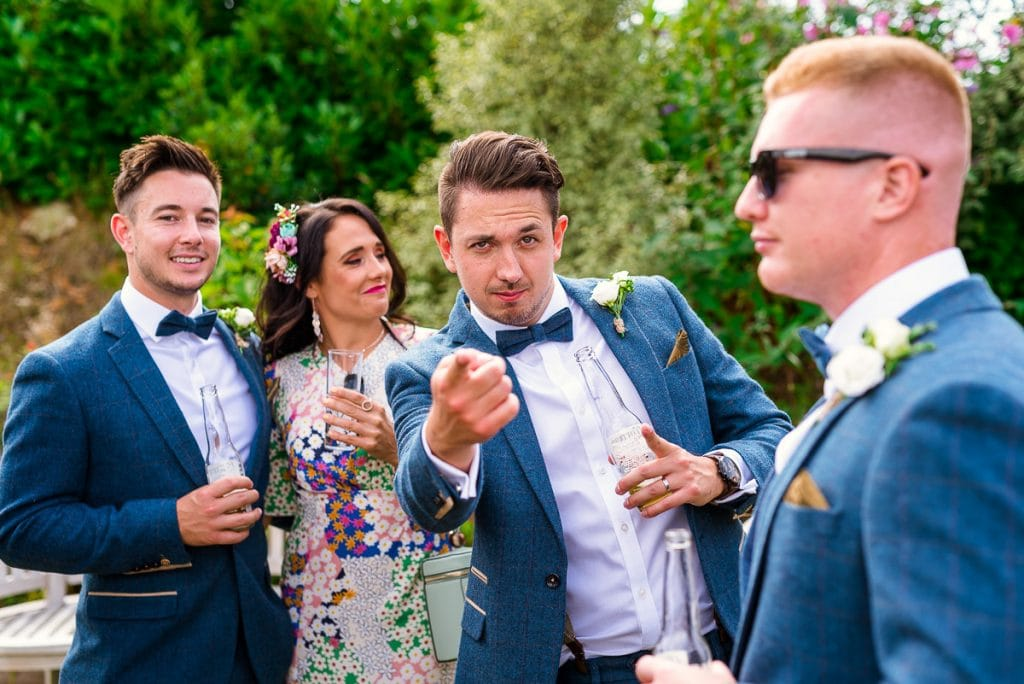 Cool groomsmen during wedding at Manor Mews
