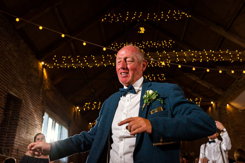 Father of the groom dancing like there's no tomorrow