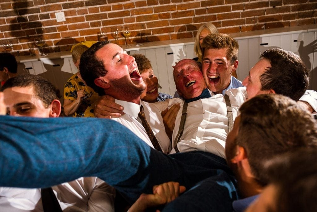 Father of the groom partying with groomsmen at Manor Mews wedding reception