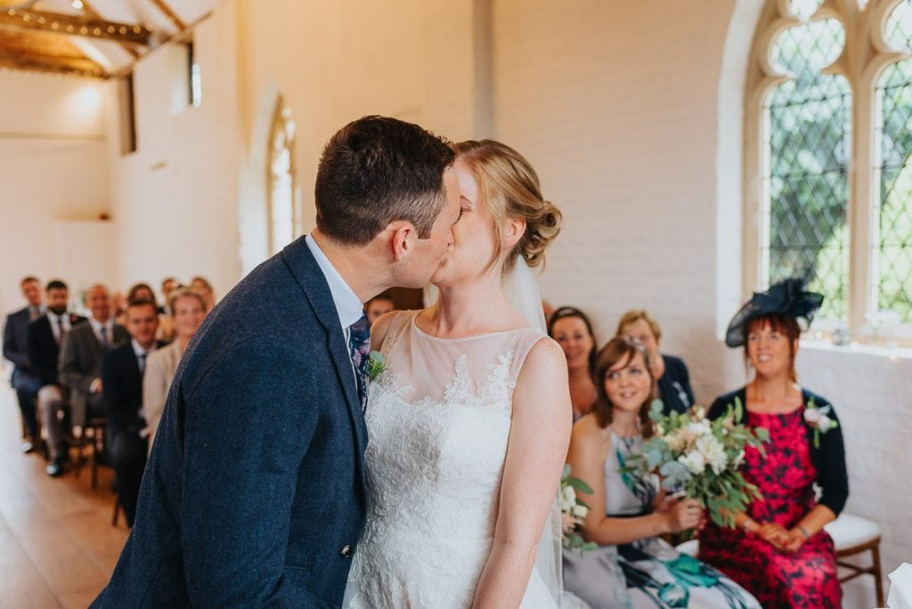 First kiss at The Reading Room wedding in Alby