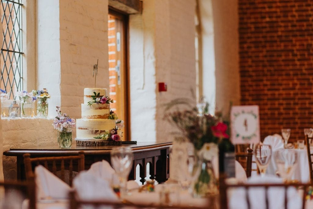 Semi-naked wedding cake at The Reading Room Wedding in Alby, Norfolk