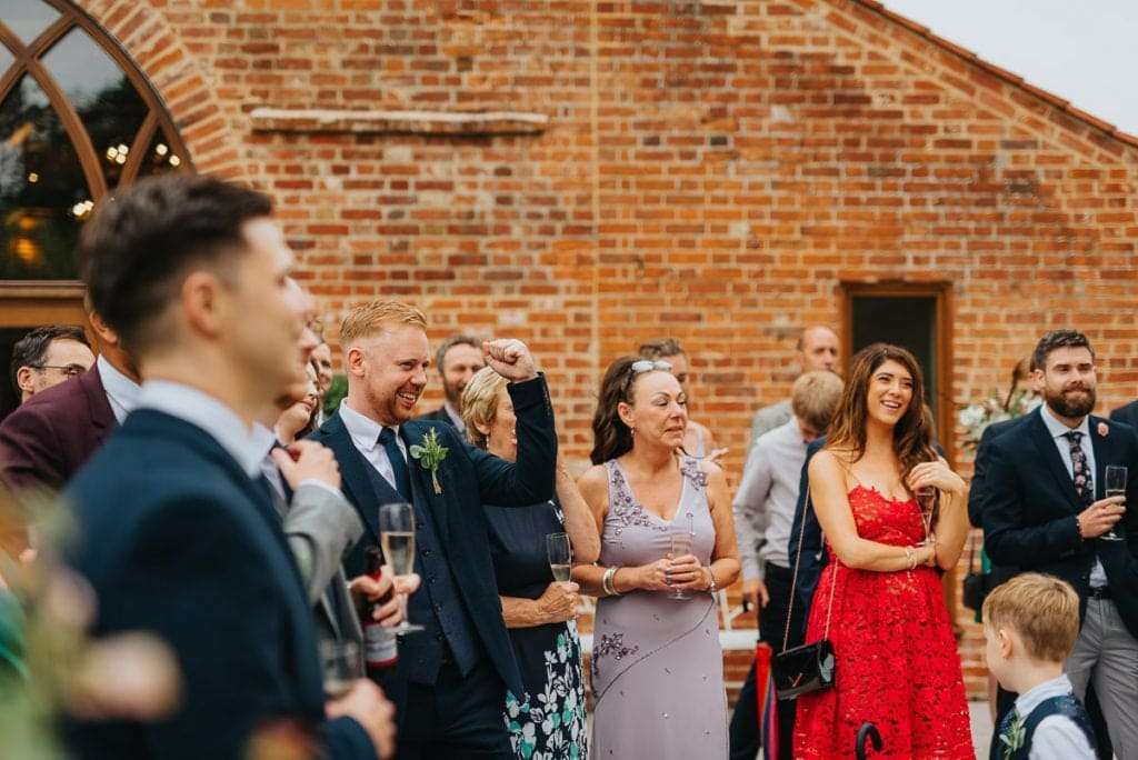 Guest reactions during groom speeches